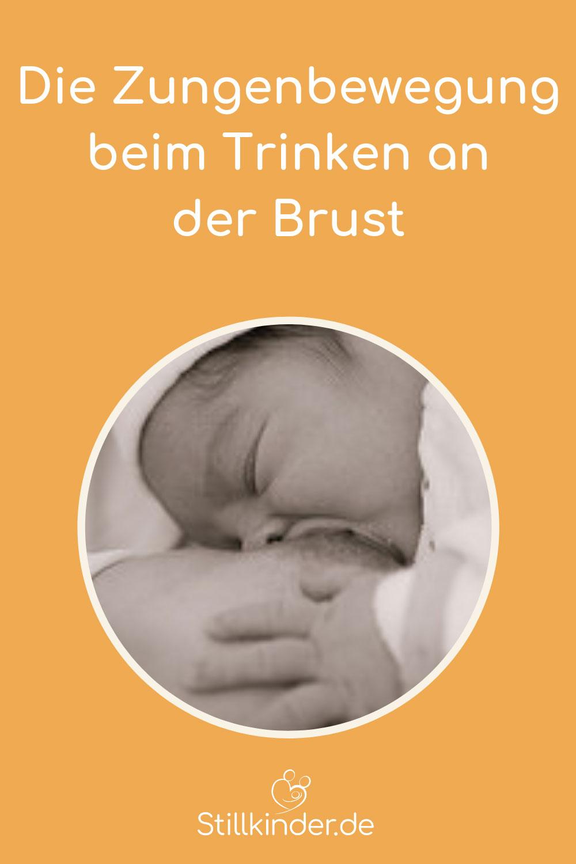 Ein Neugeborenes saugt an der Brust